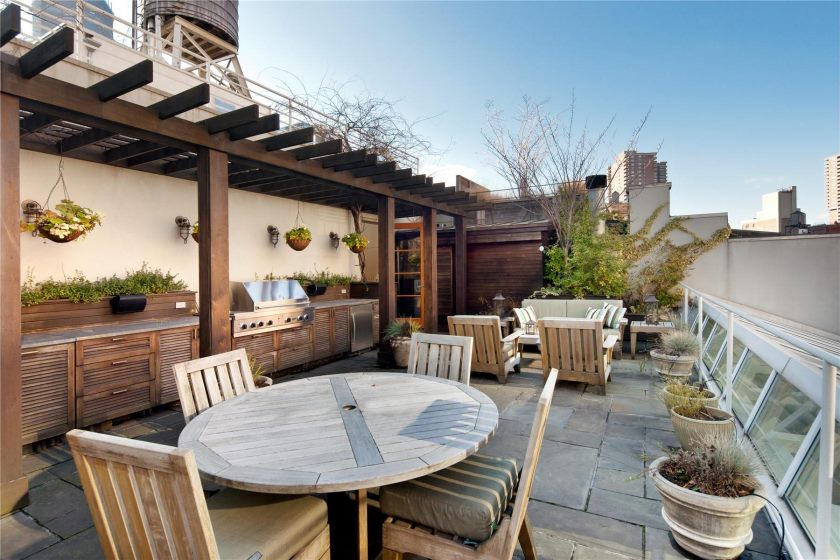 natural-modern-patio-of-the-luxury-penthouses-new-york-that-seems-nice-with-wooden-materials-applied-on-the-patio-by-applying-round-wooden-table-and-also-wooden-chair-that-seens-natural-nuance-inside